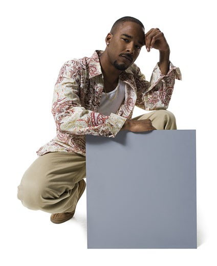 African American man holding a blank sign : Stock Photo