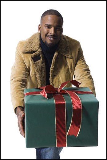 Stock Photo: 1660R-29200 African American man with Christmas gift