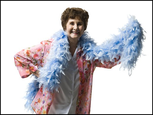 Stock Photo: 1660R-29474 Elderly woman with a feather boa