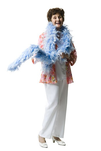 Elderly woman with a feather boa : Stock Photo