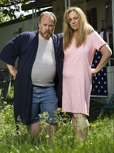 Overweight couple in a trailer park : Stock Photo