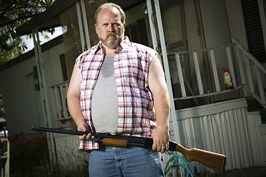 Stock Photo: 1660R-29527 Overweight man with a shotgun
