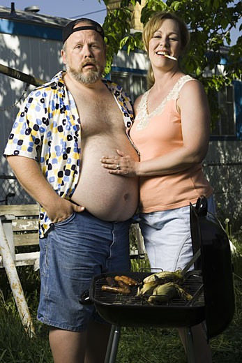 Stock Photo: 1660R-29545 Overweight couple in a trailer park