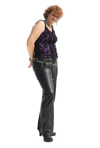 Stock Photo: 1660R-29838 Smiling woman with red hair in leather pants