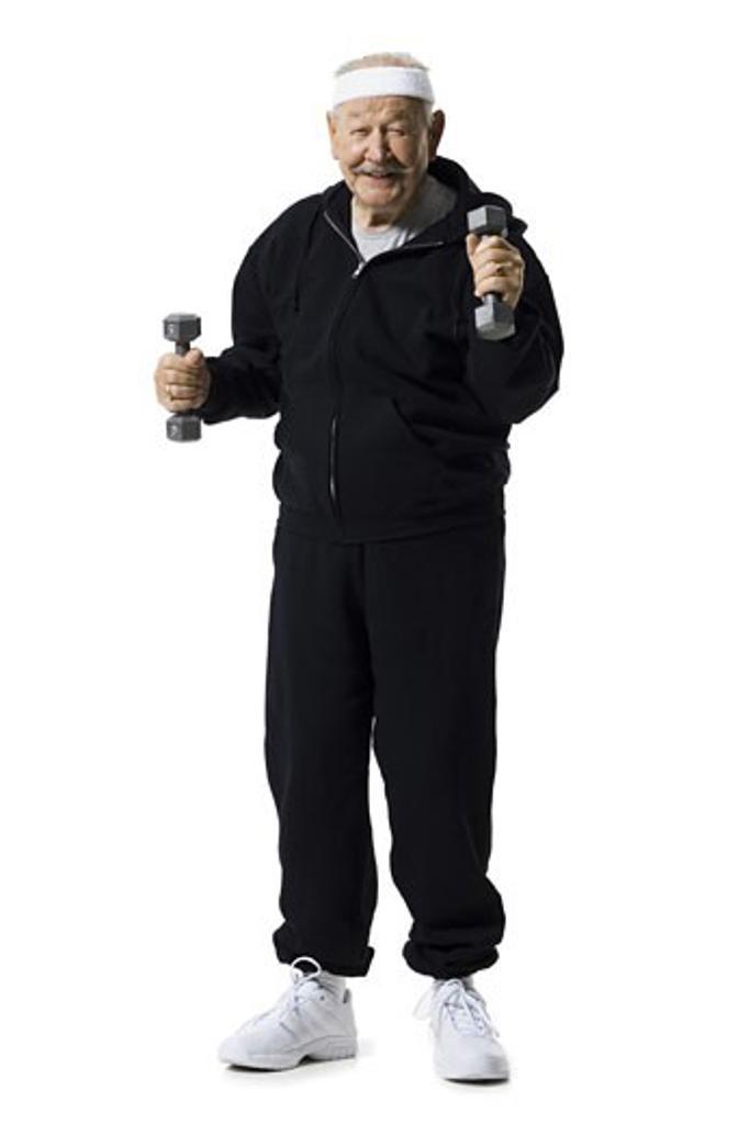 Older man doing dumbbell exercises : Stock Photo