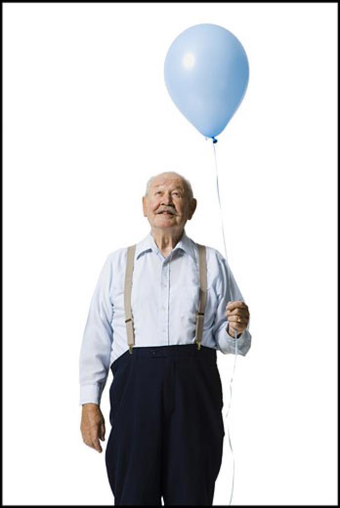 Stock Photo: 1660R-30075 Older man holding balloon