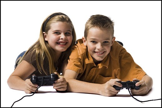 Two brothers playing a video game : Stock Photo
