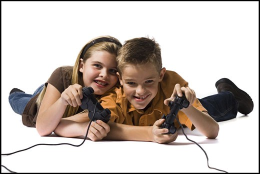 Brother and sister playing a video game : Stock Photo
