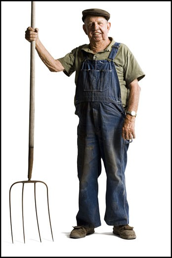 Stock Photo: 1660R-30697 Farmer holding a pitchfork