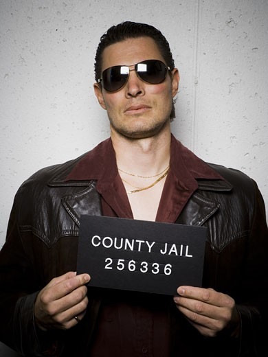 Mug shot of man with cigarette and sunglasses : Stock Photo
