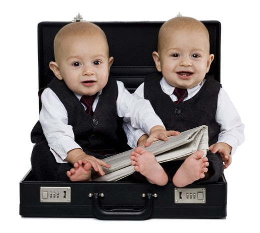 Stock Photo: 1660R-30945 Twin baby boys in briefcase with suits and newspaper