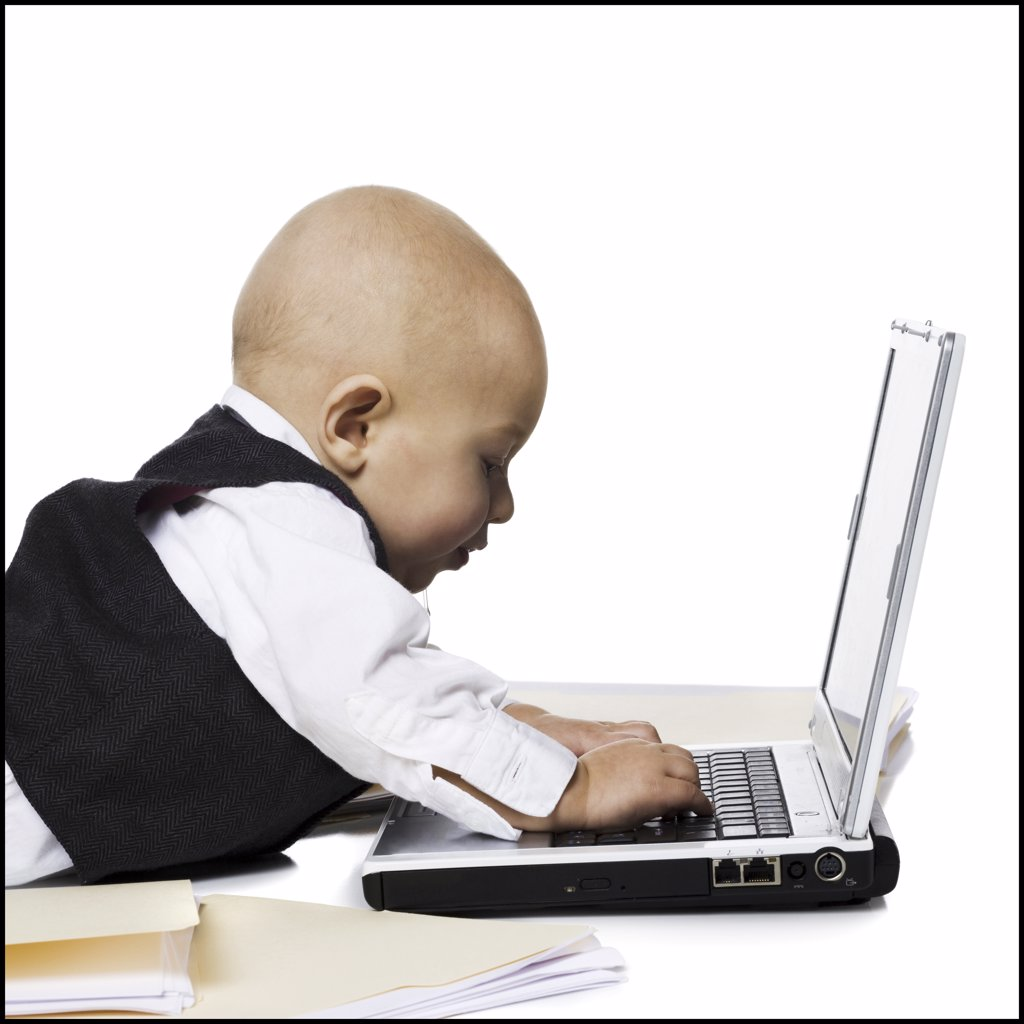 Baby Boy in suit with laptop : Stock Photo