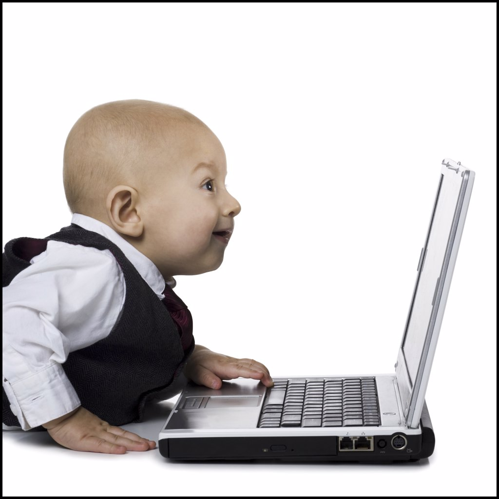 Stock Photo: 1660R-30952 Baby boy in suit with laptop
