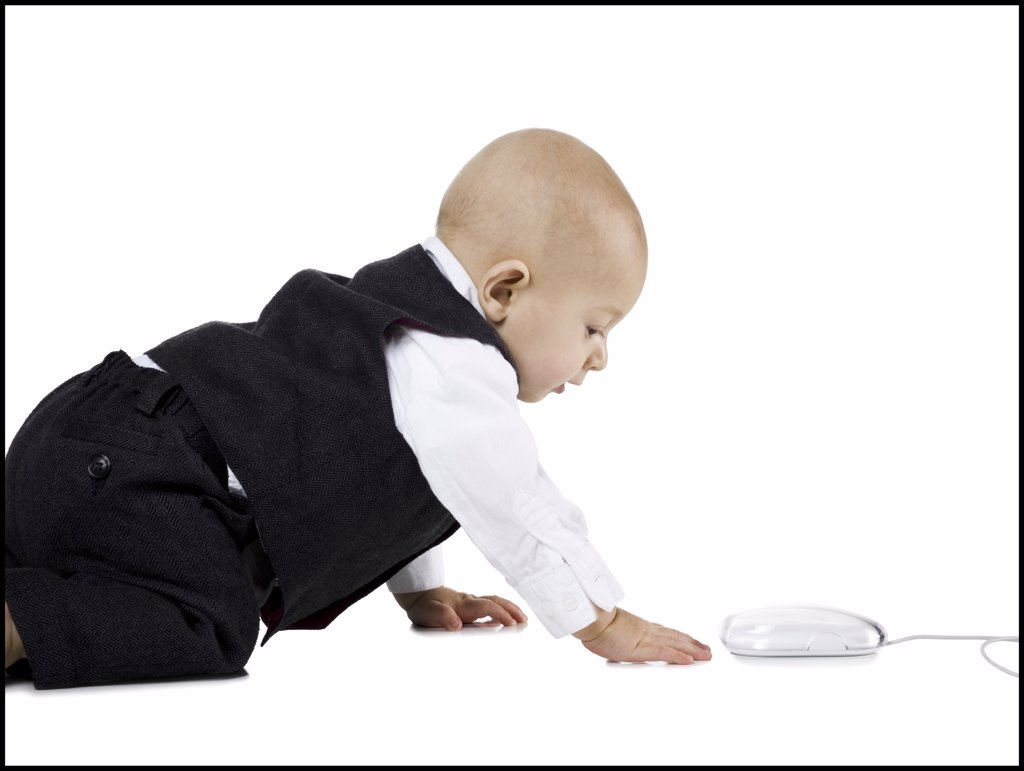 Baby Boy in suit crawling to computer mouse : Stock Photo