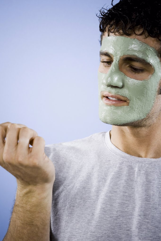Stock Photo: 1660R-31004 Man with cosmetic facial mask