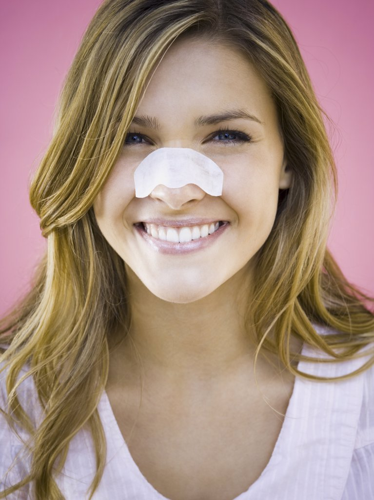 Stock Photo: 1660R-31031 Woman with cleansing strip on nose