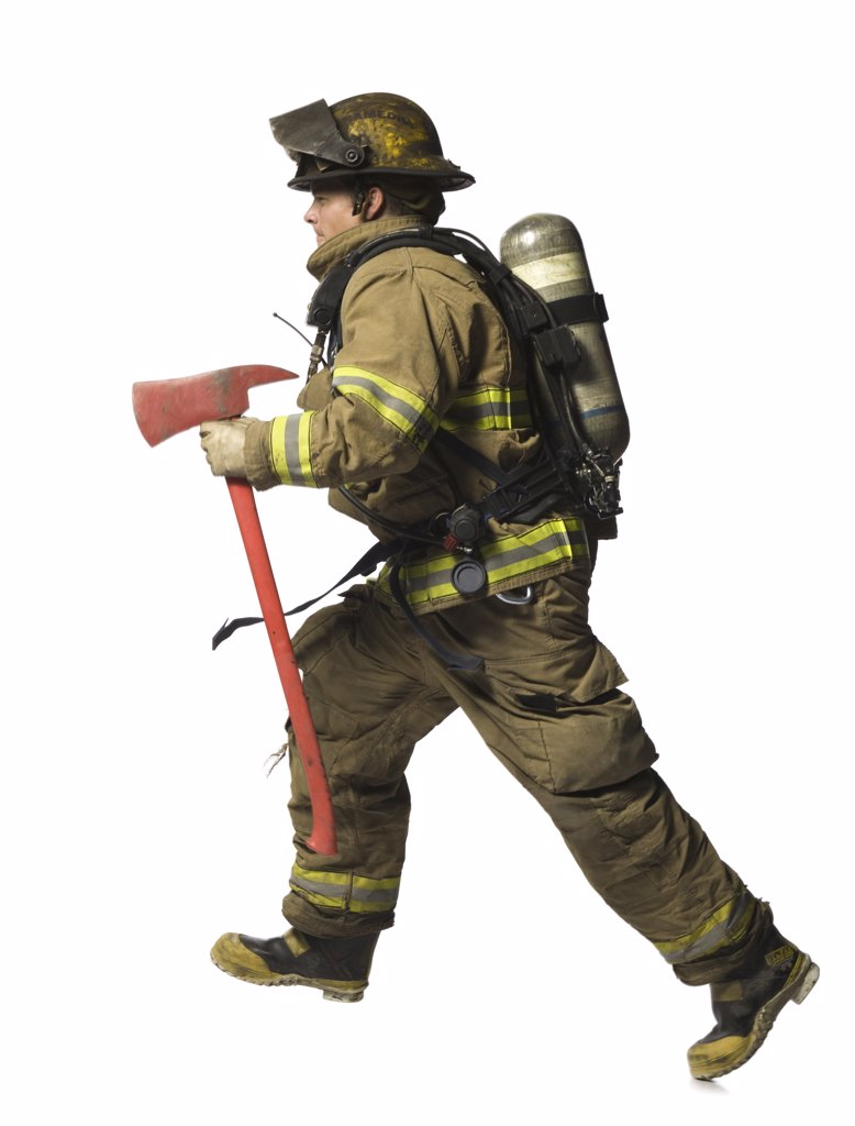 Firefighter running with axe : Stock Photo