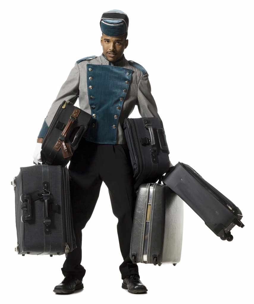 Stock Photo: 1660R-31232 Bellboy with luggage struggling