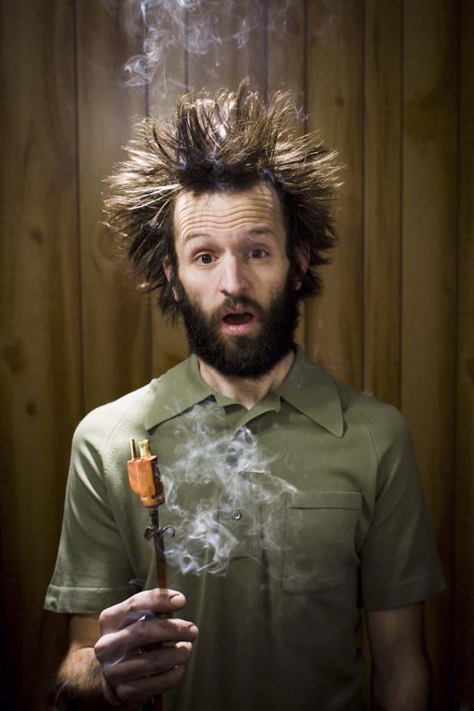 Stock Photo: 1660R-31373 Man with smoking hair and electrical plug