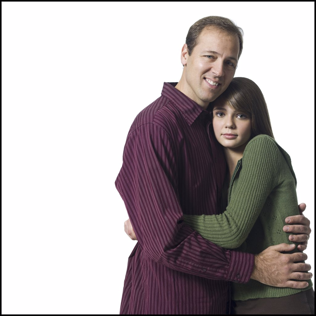 Man and girl embracing : Stock Photo