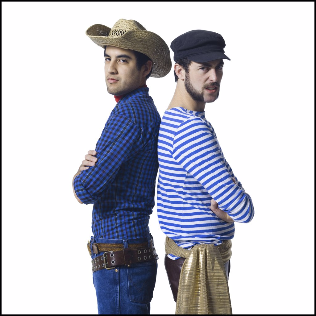 Stock Photo: 1660R-31608 Man in cowboy costume and man in leather pants with waist sash standing back to back