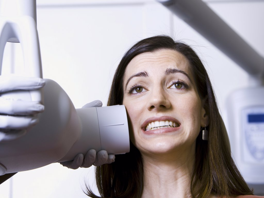 Stock Photo: 1660R-31645 Woman having dental x-rays