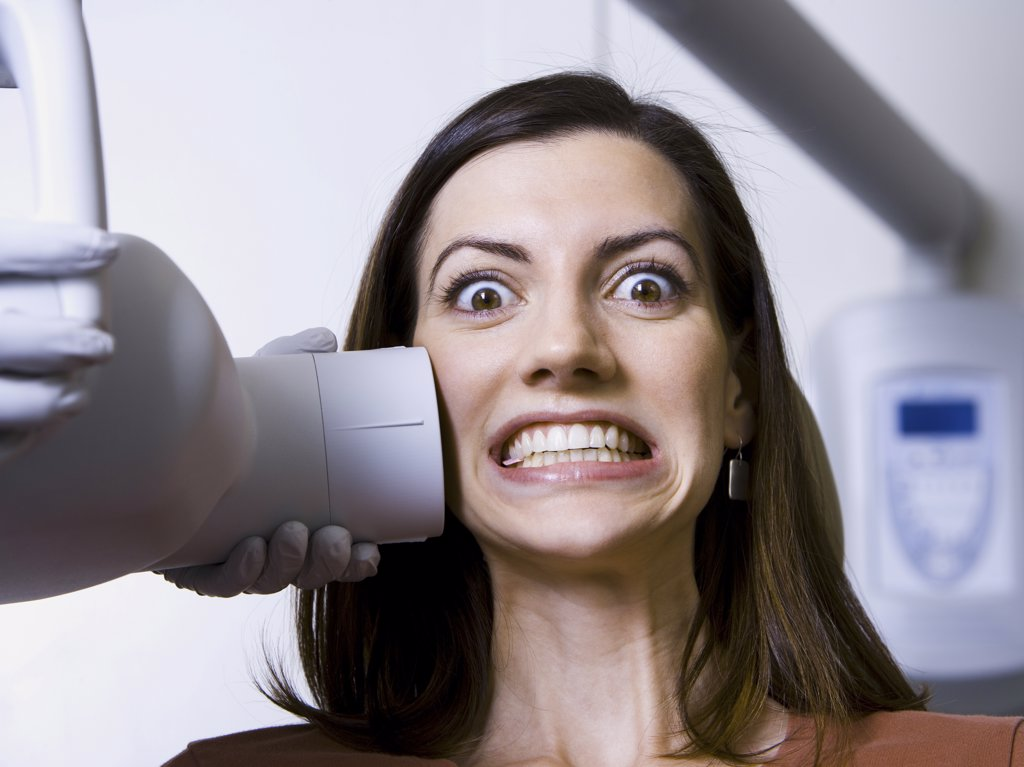 Woman having dental x-rays : Stock Photo