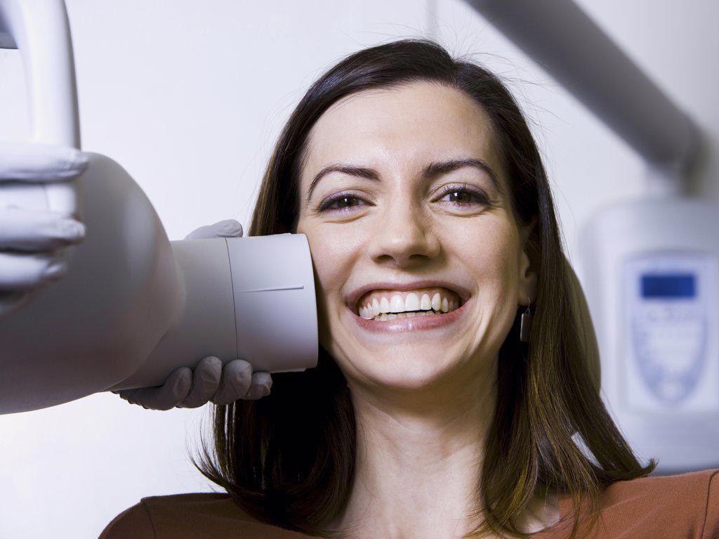 Stock Photo: 1660R-31647 Woman having dental x-rays