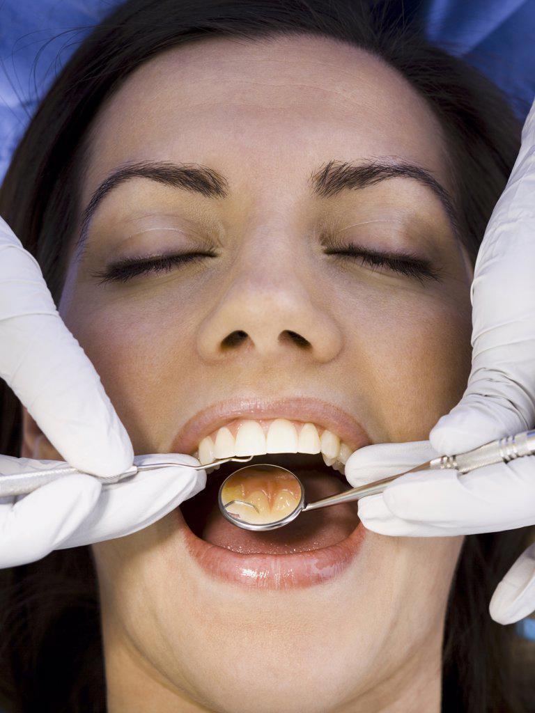 Woman having dental examination : Stock Photo