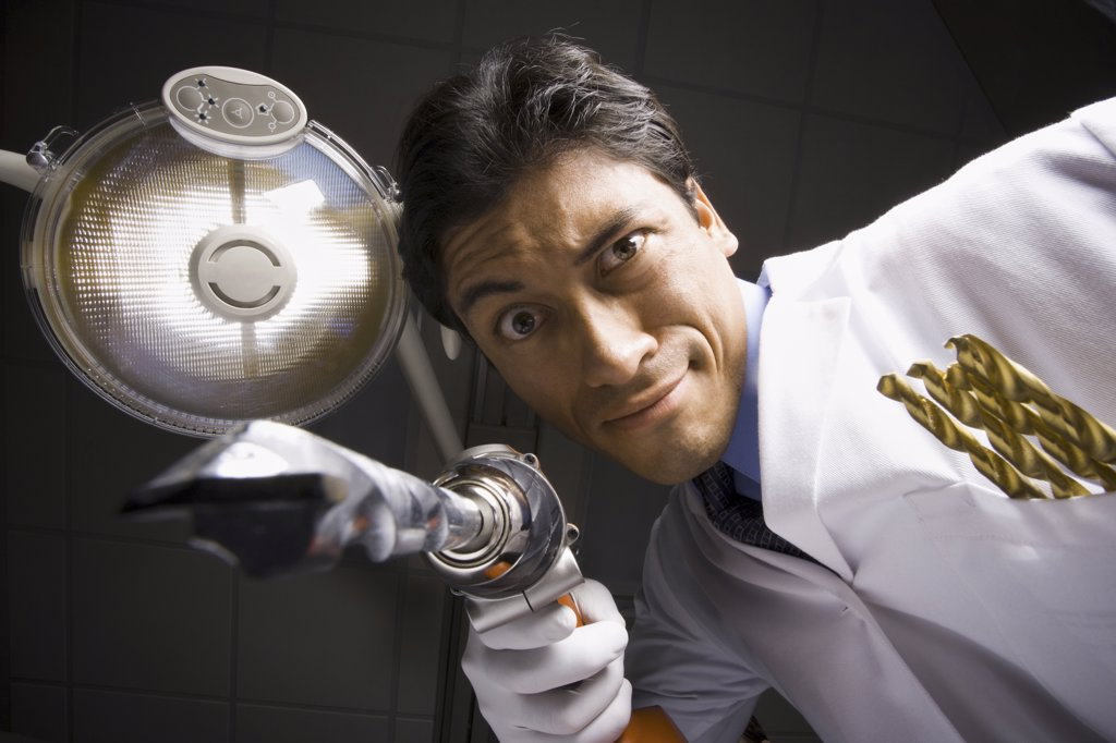 Stock Photo: 1660R-31796 Dentist with drill dramatic angle