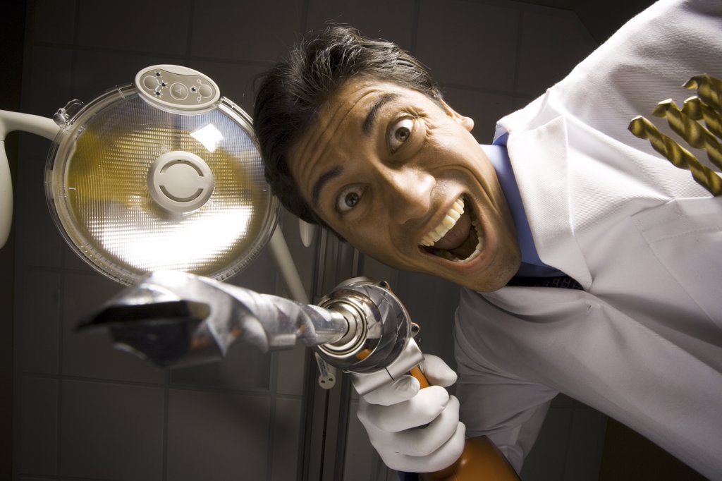 Stock Photo: 1660R-31797 Dentist with drill dramatic angle