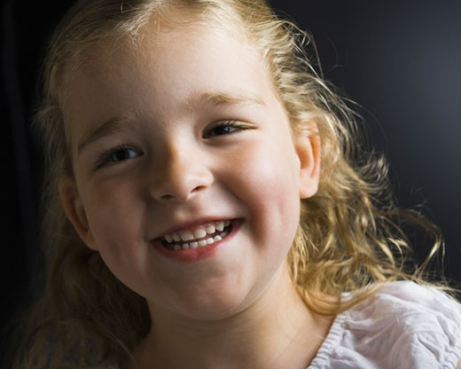 Close-up of a girl smiling : Stock Photo