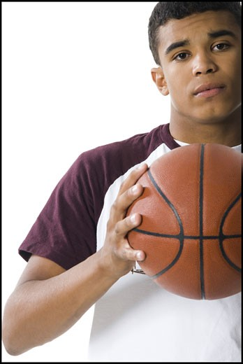 Portrait of a young man holding a ball : Stock Photo