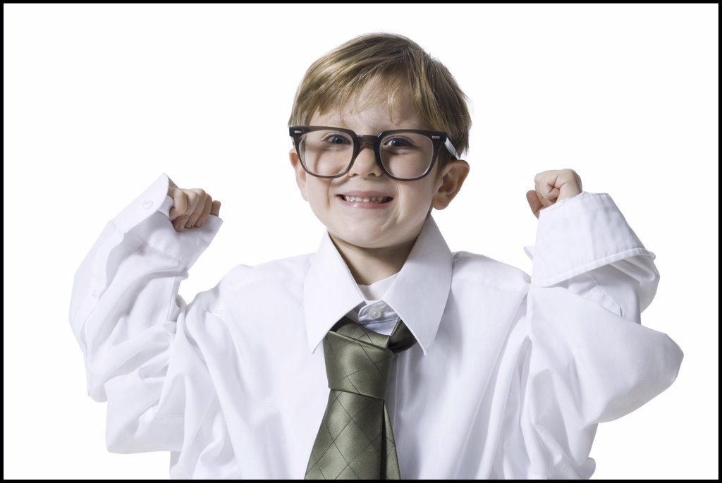 Little boy dressed as business executive : Stock Photo