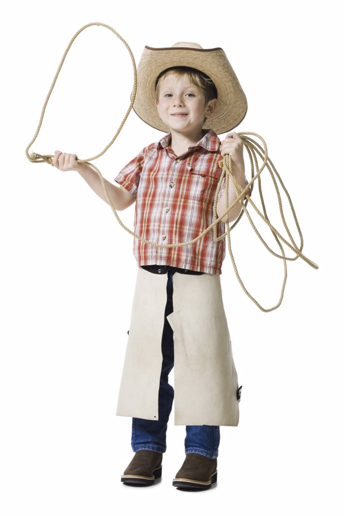 Boy with cowboy hat and lasso : Stock Photo