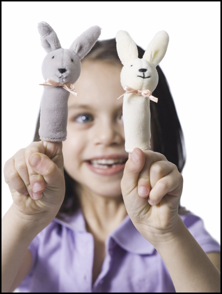 Stock Photo: 1660R-32828 Girl with finger puppets