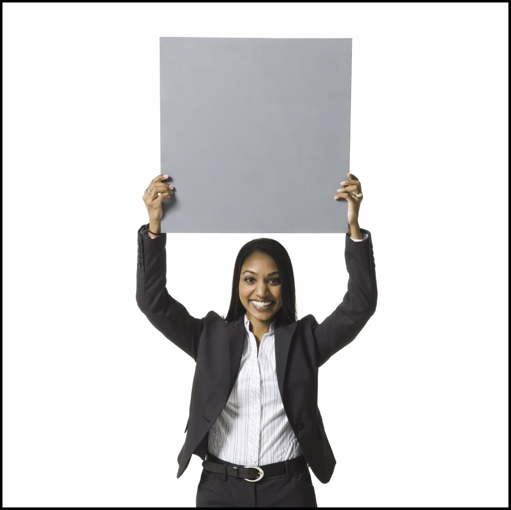 Businesswoman standing with blank sign over head : Stock Photo