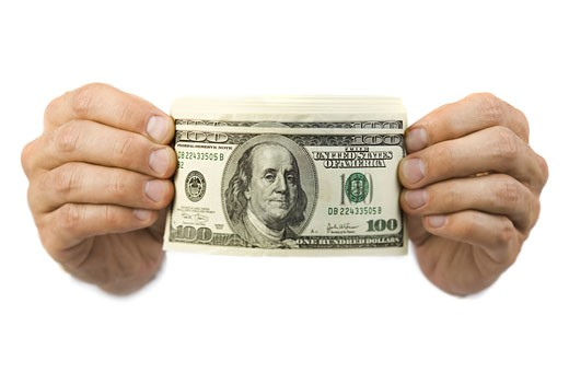 Close-up of a hands holding one hundred dollar bills : Stock Photo
