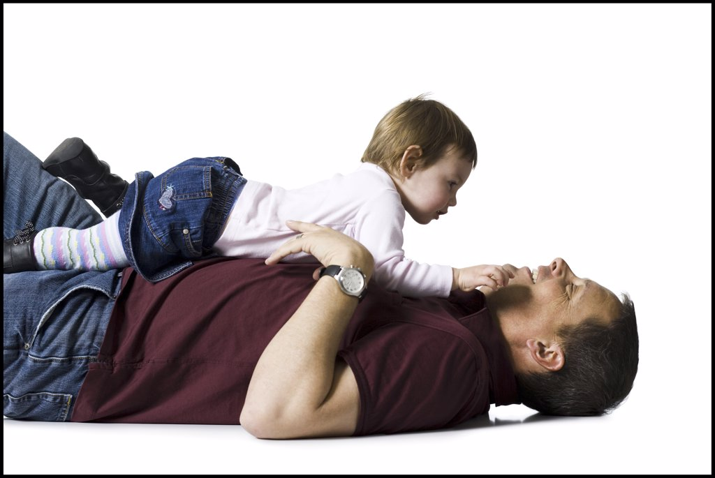 Stock Photo: 1660R-33531 Side profile of man with baby girl snuggling