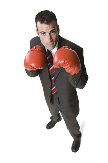 Stock Photo: 1660R-3403 High angle view of a businessman wearing boxing gloves