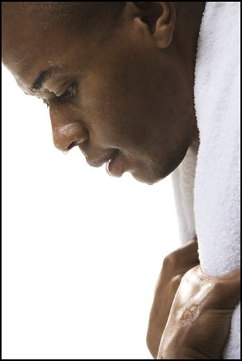 Close-up of a young man sweating after a work out : Stock Photo