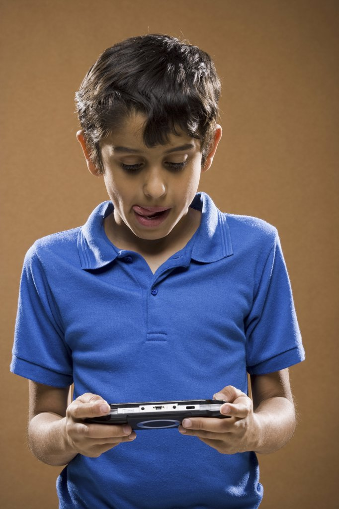Boy holding video game smiling : Stock Photo