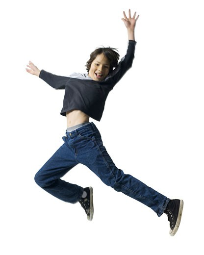 Boy jumping in the air : Stock Photo
