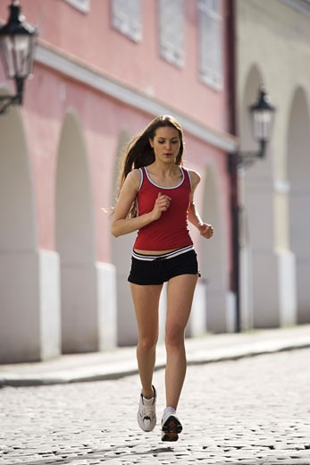 Stock Photo: 1660R-3504 Low angle view of a young woman jogging