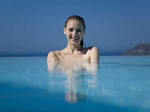 Stock Photo: 1660R-35068 Woman in outdoor pool smiling