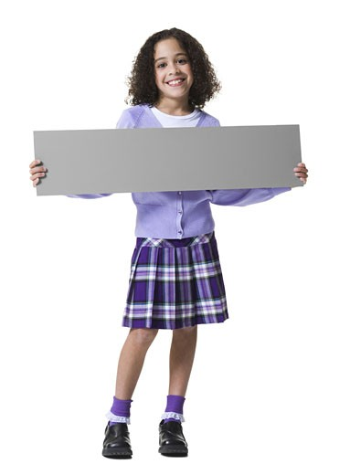 Portrait of a girl holding a blank sign : Stock Photo