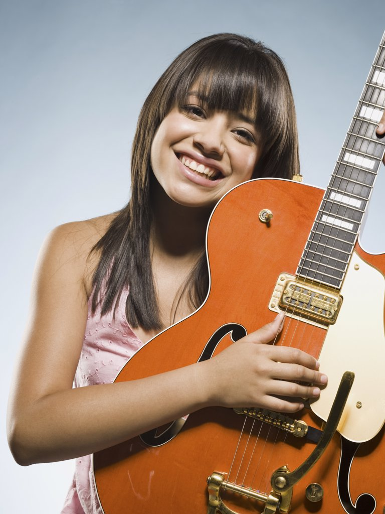Woman playing guitar : Stock Photo