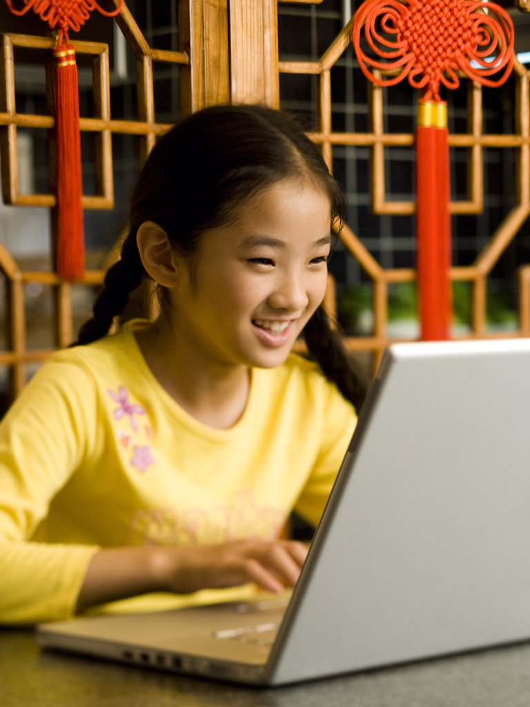 Girl sitting with laptop smiling : Stock Photo