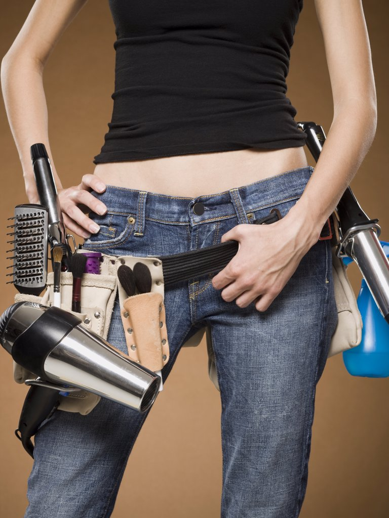 Mid section view of hairdresser with tool belt : Stock Photo