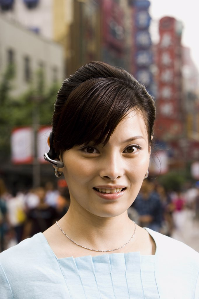 Woman with a cell phone earpiece. : Stock Photo